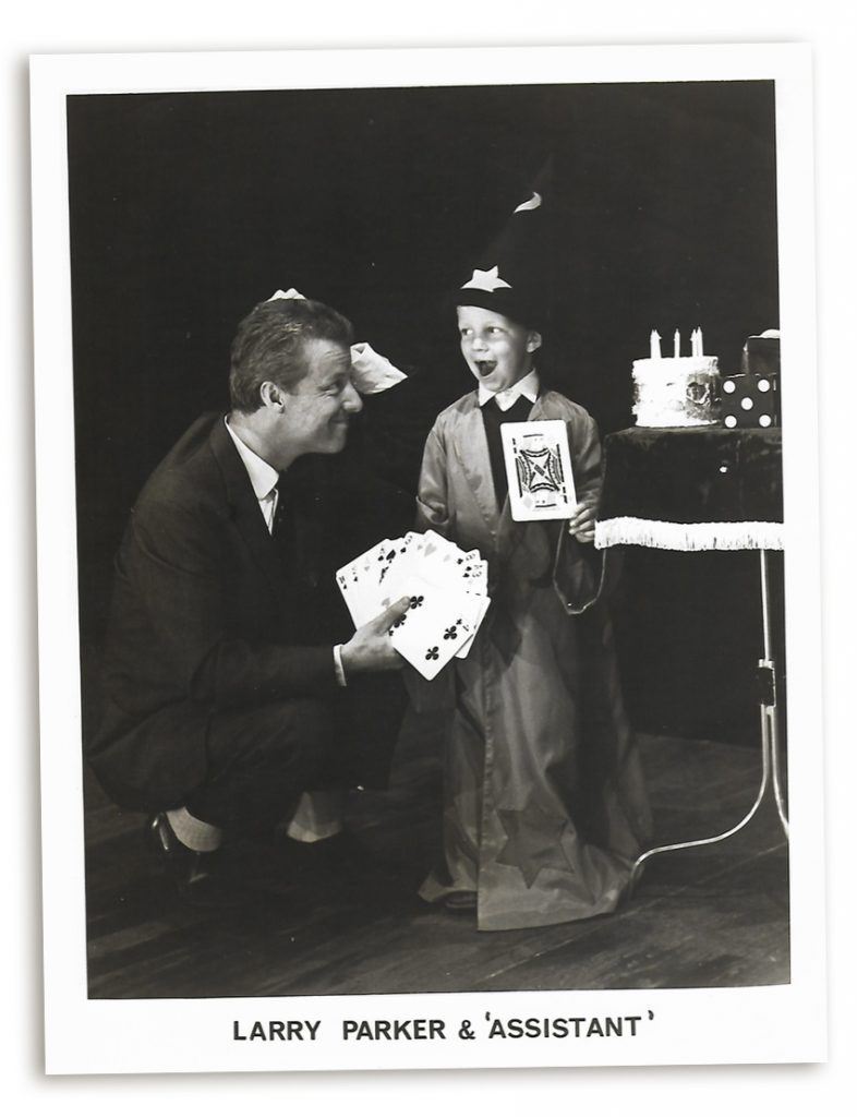 Magician Larry Parker with a young assistant